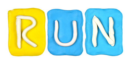 Colorful plasticine alphabet form word RUN photo