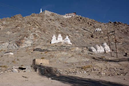 White buddhist chortens in mountains valley near Leh, Ladakh, India  photo