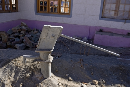 hand carved: Hand water pump (retro style) in Leh, India