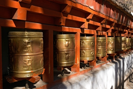 potala: Buddhist prayer wheels in Tibetan monastery