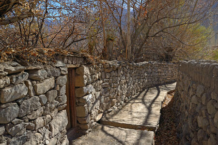 mud house:  bricks wall on the road in Ladakh, Northern India  Stock Photo
