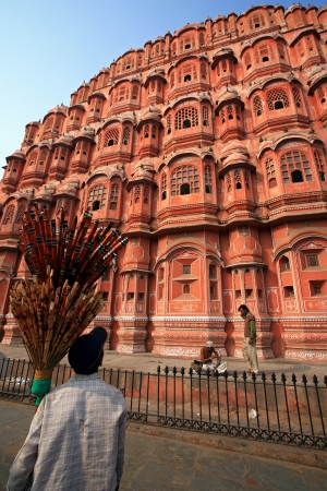 latticework: JAIPUR, INDIA - DECEMBER 10: Hawa Mahal or Palace of Winds. It was built of pink sandstone in 1799. 953 small windows are decorated with intricate latticework; December 10, 2006 in Jaipur,India