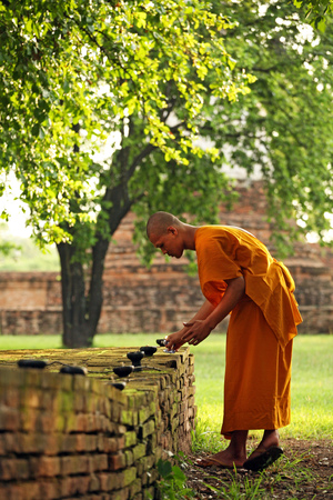 ordinate: AYUTTHAYA , THAILAND - AUGUST 10: Monks prepare candle for tradition buddish ceremony on August 10, 2006 AYUTTHAYA, Thailand.