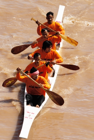 catchment: AYUTTAYA, THAILAND - AUG 21 : Unidentified crew in traditional Thai long boats competiton on August 21, 2008,Ayuttaya, Thailand.  Editorial