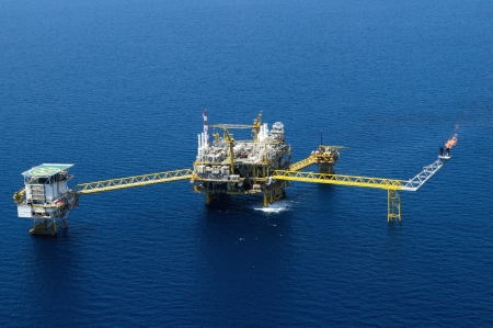 An offshore oil and gas platform in the Gulf of Thailand from aerial view.
