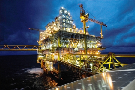 offshore: twilight of an offshore oil rig at Thailand. Stock Photo