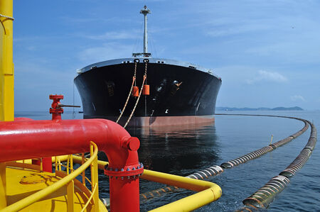 Supply vessel during operation along side with a drilling rig.  Stock Photo