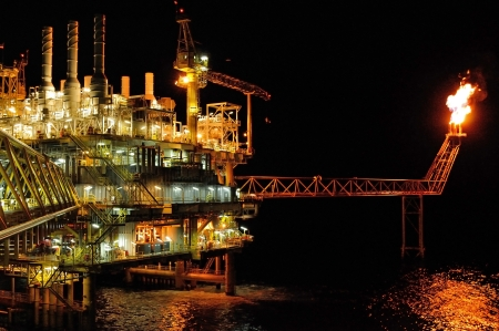 twilight of an offshore oil rig at Thailand. Stock Photo