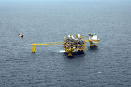 An offshore oil and gas platform in the Gulf of Thailand from aerial view. photo