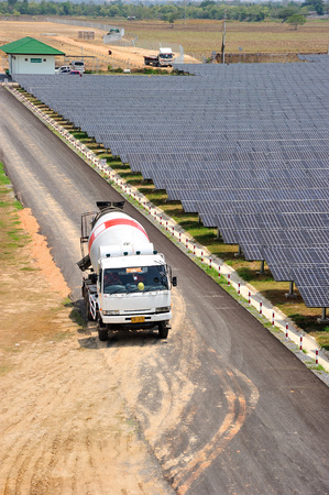 NAKORNRACHASRIMA, THAILAND - APRIL 21: truck in solar farm  on April 21, 2011 in Nakornrachasrima, Thailand.