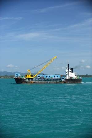 cargo ship  drop container in the sea for artificial reef in Nakornsrithammarat, Thailand. photo
