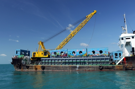 cargo ship  drop container in the sea for artificial reef in Nakornsrithammarat, Thailand.