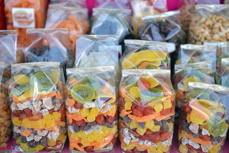 dried fruit vendor waits for tourists in Khunwang, Chiangmai, Thailand. photo