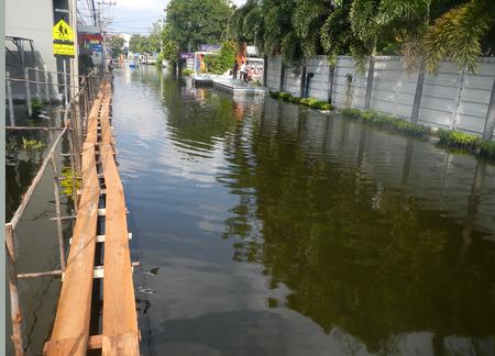 worst: BANGKOK, THAILAND - NOV 10: The worst flood on village at Taling Chan distric after Thai flood crisis on November 10, 2011 in Bangkok, Thailand