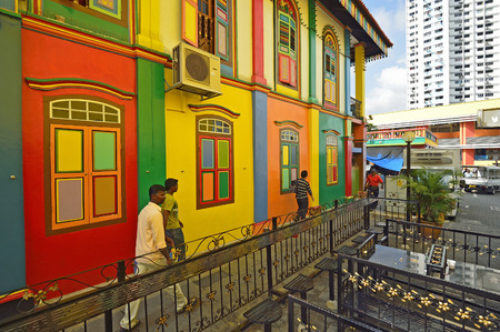 SINGAPORE- MAY 1: Unidentified people around Colorful facade of building in Little India on May 1, 2012 in Singapore.