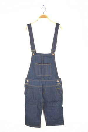 dungarees: hanging dungarees on white wall