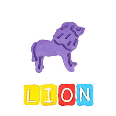 Color childrens lion plasticine on a white background