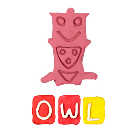 Color childrens owl plasticine on a white background