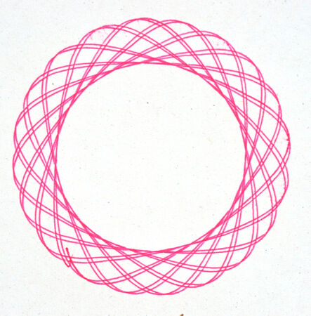 oscillation: drawing spirograph on white paper Stock Photo