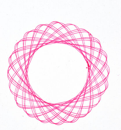 drawing spirograph on white paper photo