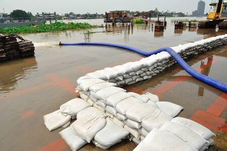 natural disaster: NONTABURI, THAILAND - OCT 10:  Flooding in Nontaburi on October 26, 2010 in Nontaburi, Thailand.