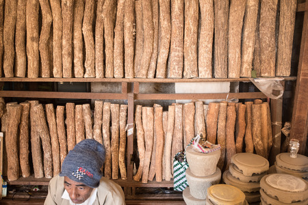 face in tree bark: BAGAN, MYANMAR - DEC 19: Unidentified people in thanaka wood and Kyauk Pyin stone slabs shop  on Dec 19, 2014 in Bagan. Editorial