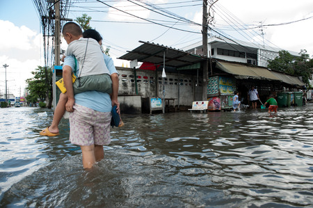 flood damage: SAMUTPRAKARN, THAILAND - NOVEMBER 08: Heavy flooding from monsoon rain and tide from sea in Samutprakarn near Bangkok on November 8, 2009 in Samutprakarn, Thailand.