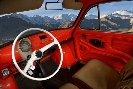 vintage car interior with landscape montage photo