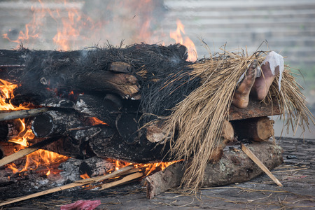 KATHMANDU, NEPAL - MAY 03 : Kathmandu residents perform cremation rituals for their relatives killed in an earthquake at the Pashupatinath Temple in Kathmandu, Nepal on May 03, 2015.