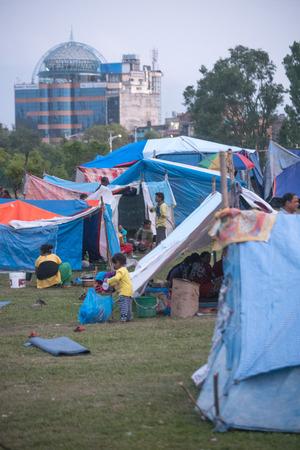 richter: KATHMANDU, NEPAL - MAY 1, 2015: People living in temporary shelter near airport, earthquake hit Kathmandu. Editorial