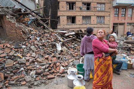 kathmandu: KATHMANDU, NEPAL - APRIL 30, 2015: Nepalese women wait to fill buckets with water at Pakhtapur in Kathmandu.