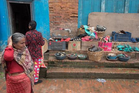 quake: KATHMANDU, NEPAL - APRIL 30, 2015: People are seen among the debris of buildings in the Bhaktapur city, 20km from the capital Kathmandu