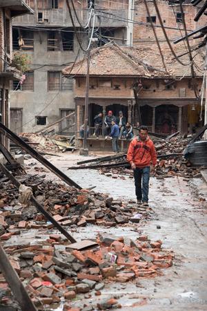 richter: KATHMANDU, NEPAL - APRIL 30, 2015: People are seen among the debris of buildings in the Bhaktapur city, 20km from the capital Kathmandu