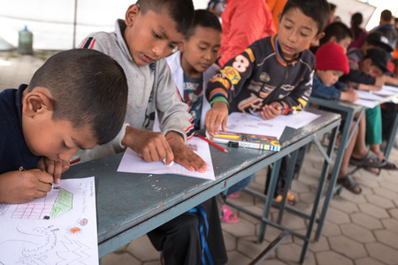suffered: KATHMANDU, NEPAL - APRIL 30, 2015: childern drawing at basketball field in Bakhtapur school, Nepal suffered a magnitude 7.8 earthquake killing over 7,000 people and injuring thousands more. Editorial