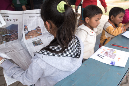 injuring: KATHMANDU, NEPAL - APRIL 30, 2015: childern drawing at basketball field in Bakhtapur school, Nepal suffered a magnitude 7.8 earthquake killing over 7,000 people and injuring thousands more. Editorial