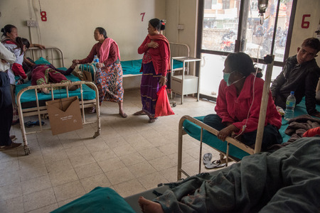 magnitude: KATHMANDU, NEPAL - APRIL 30, 2015: People wait for treatment at Pakhtapur Hospital in Kathmandu, Nepal suffered a magnitude 7.8 earthquake killing over 7,000 people and injuring thousands more. Editorial