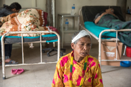 suffered: KATHMANDU, NEPAL - APRIL 30, 2015: People wait for treatment at Pakhtapur Hospital in Kathmandu, Nepal suffered a magnitude 7.8 earthquake killing over 7,000 people and injuring thousands more. Editorial