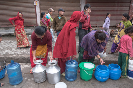 quake: KATHMANDU, NEPAL - APRIL 29, 2015: people collects water near Boudhanath pagoda, earthquake hit Kathmandu. Editorial