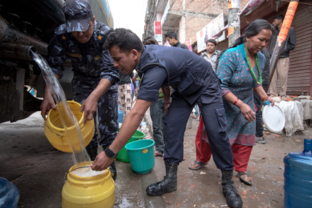 richter: KATHMANDU, NEPAL - APRIL 29, 2015: people collects water near Boudhanath pagoda, earthquake hit Kathmandu. Editorial