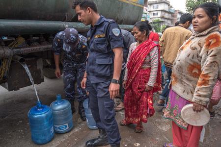 richter: KATHMANDU, NEPAL - APRIL 29, 2015: people collects water near Boudhanath pagoda, earthquake hit Kathmandu. Editorial