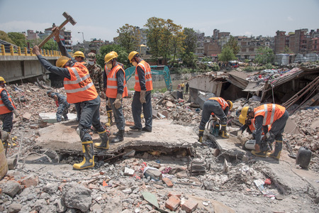 KATHMANDU NEPAL  MAY 1 2015: soldiers with debris of buildings near Sobhavagbati bridge damaged after the major earthquake on 25 April 2015. Editorial