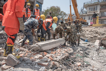 richter: KATHMANDU NEPAL  MAY 1 2015: soldiers with debris of buildings near Sobhavagbati bridge damaged after the major earthquake on 25 April 2015. Editorial