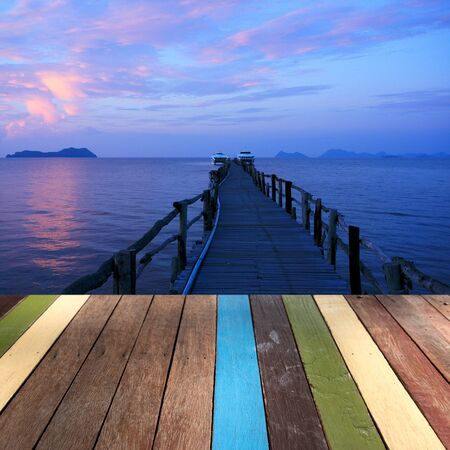 montage: Wood table top on seascape montage concept
