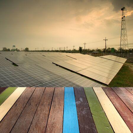 solar farm: Wood table top on solar farm montage concept