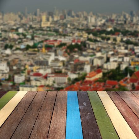 montage: Wood table top on cityscape blur background montage concept Stock Photo