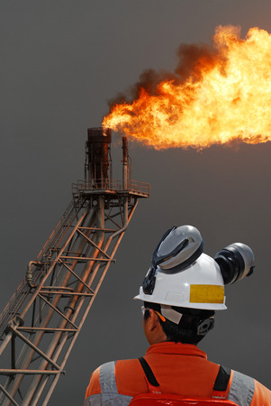 oilrig: oil worker and oil rig