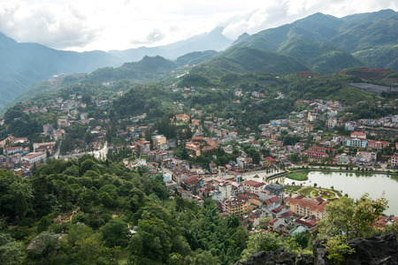 lao: Lao cai, Vietnam - June 14, 2015: town of Sapa in green season view point from Hamrong Mt. on 14 June 2015. Lao cai, Vietnam Editorial