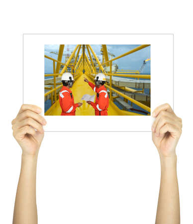 petrolium: Hands holding workers on rig picture isolated on white Stock Photo