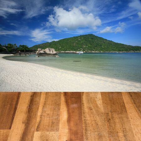 montage: Wood table top on seascape background montage concept