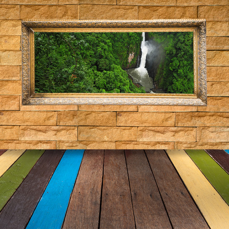 waterfall  dirty: Picture frame with photo on stone wall Stock Photo